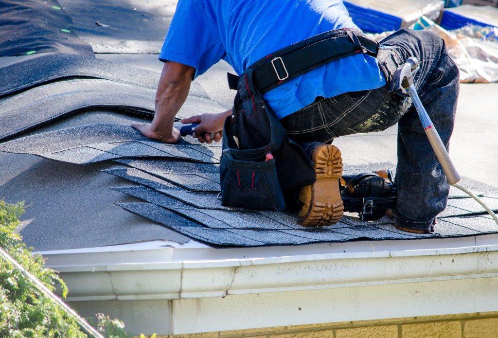 Man fixing a flat roof