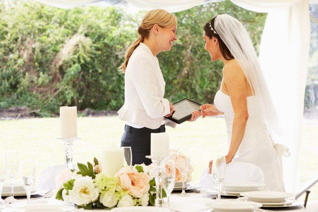 a bride with her wedding planner