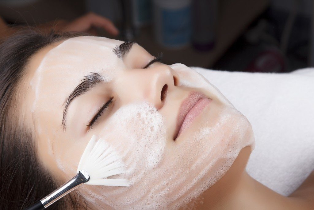 Young pretty woman receiving treatments in beauty salon