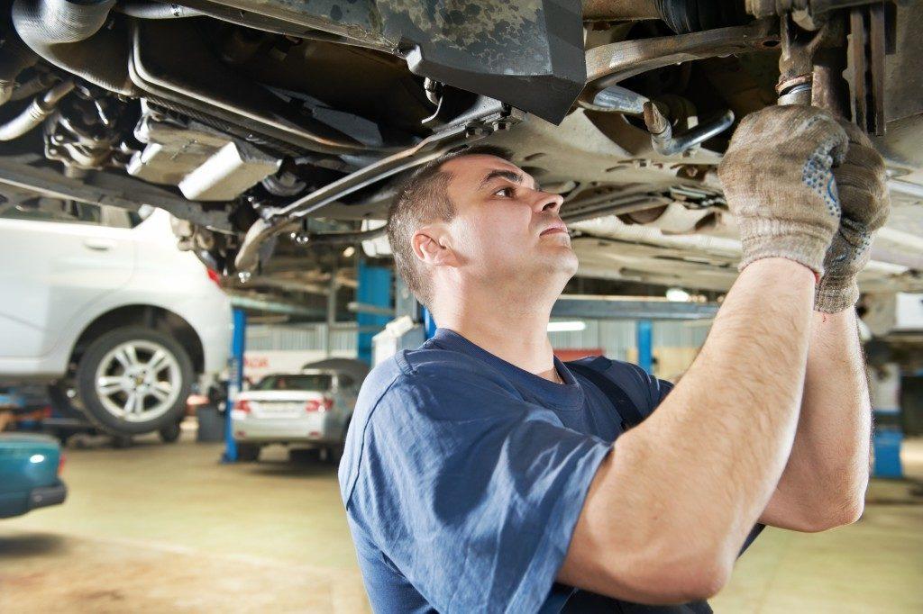 Mechanic examining car at the shop