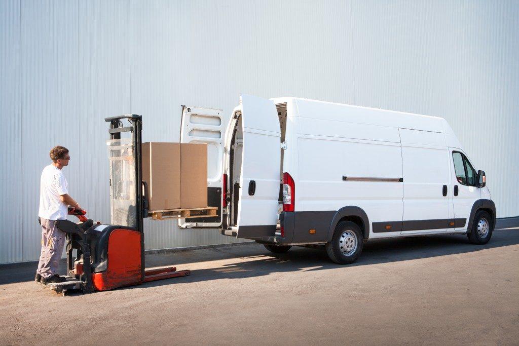 Man loading white van