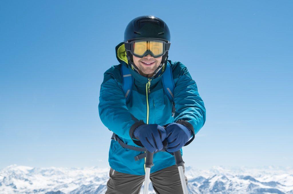Man holding his ski poles