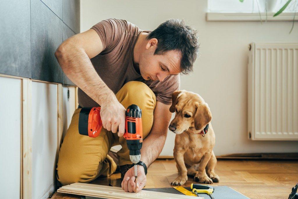 man renovating his house