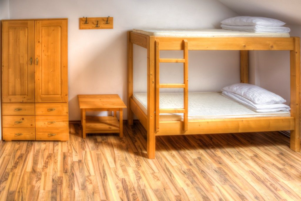 dormitory with wooden bunk beds.