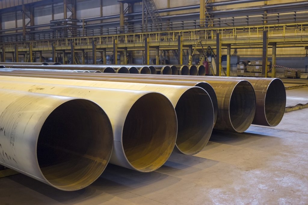 Large steel pipes in a factory
