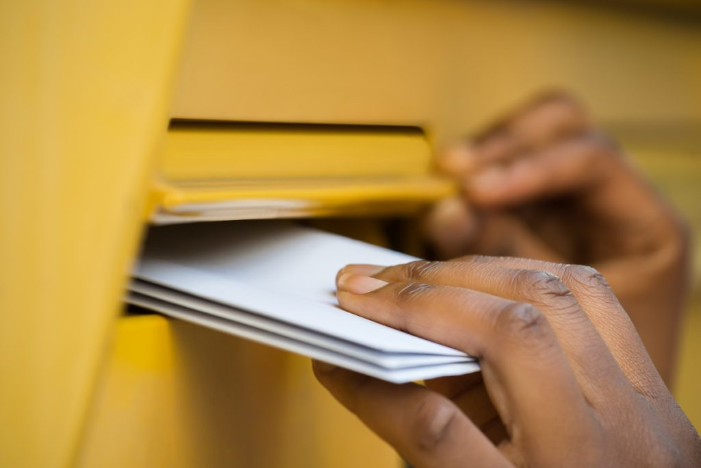 letters being put in the mail box