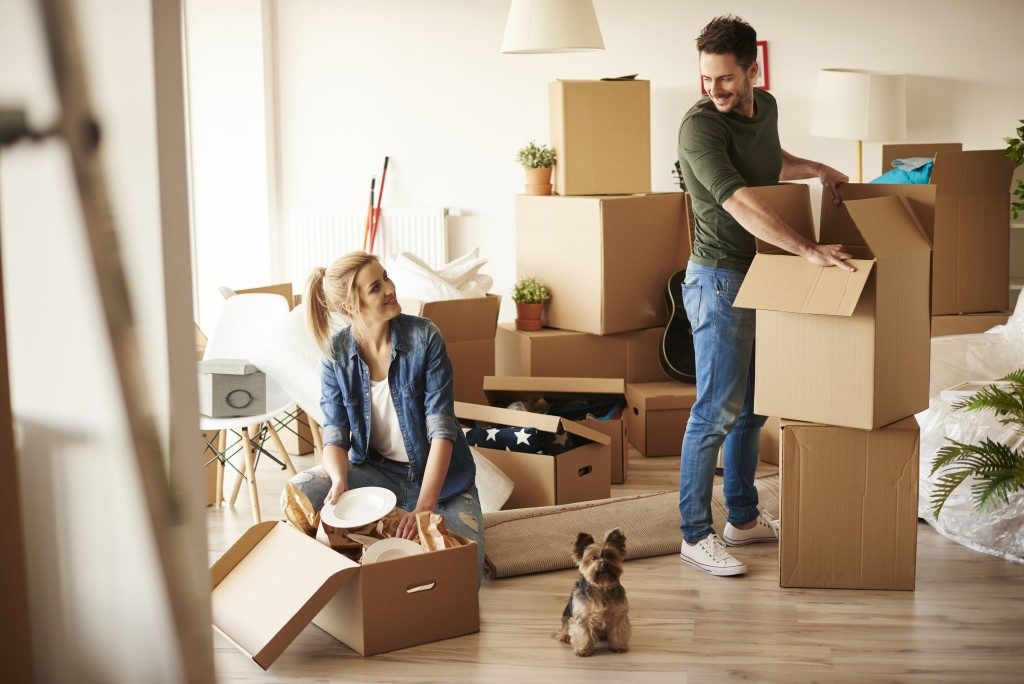 Couple unpacking new apartment
