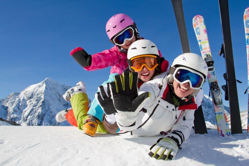 family enjoying ski holiday