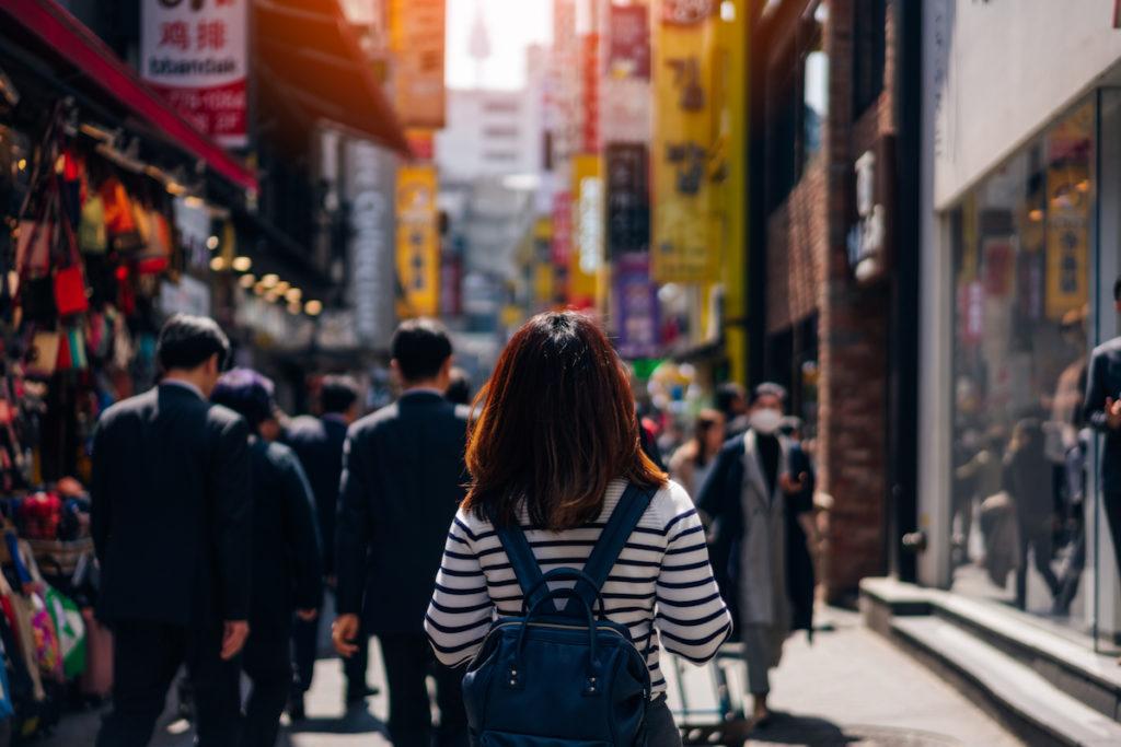 Woman walking along the streets of south korea