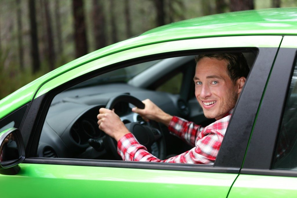 uber driver in his green car