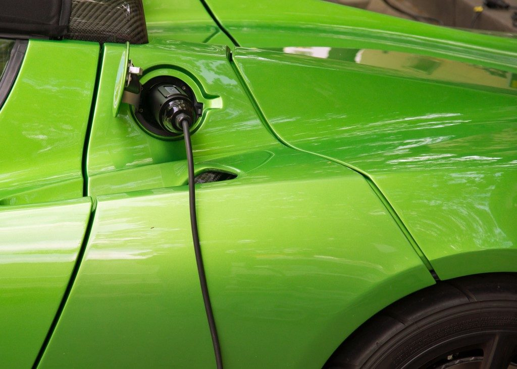 lime green electric car being charged