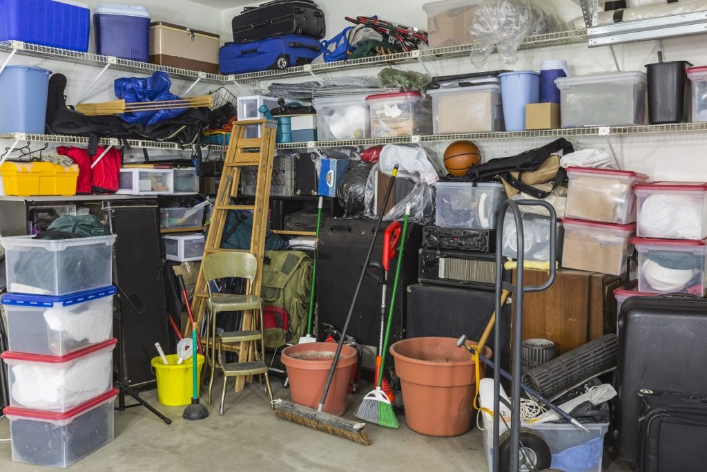 Residential garage filled with junk