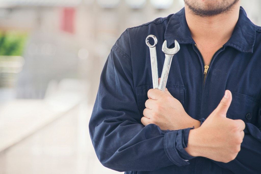 Man holding repair tools