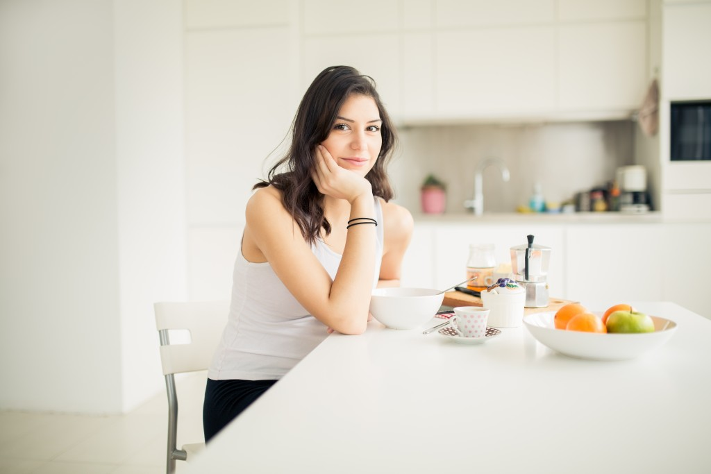 woman in the kitchen preparing healthy meal