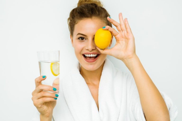 woman with bathrobe and lemon juice