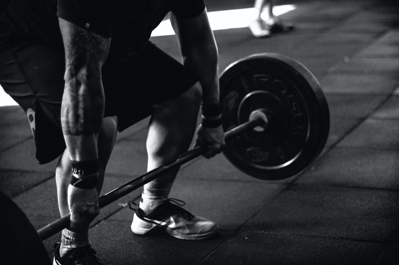 weight lifting black & white photograph