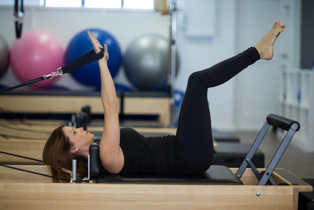 woman exercising using gym equipment